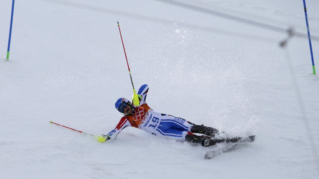 France's Thomas Mermillod Blondin crashes during the slalom run of the men's alpine skiing super combined event during the 2014 Sochi Winter Olympics at the Rosa Khutor Alpine Center in Rosa Khutor February 14, 2014. REUTERS/Leonhard Foeger (RUSSIA - Tags: OLYMPICS SPORT SKIING TPX IMAGES OF THE DAY)