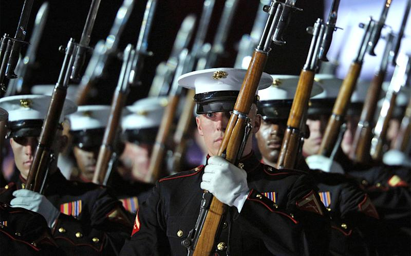 Members of the US Marines Silent Drill Platoon perform during opening ceremonies for the 2016 Invictus Games in Orlando, Florida