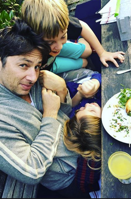 Zach Braff's kiddo companions decided he was a play structure while enjoying a meal outside. At least it looks like everyone ate their vegetables before the monkey business broke out.  (Photo: Instagram/zachbraff)