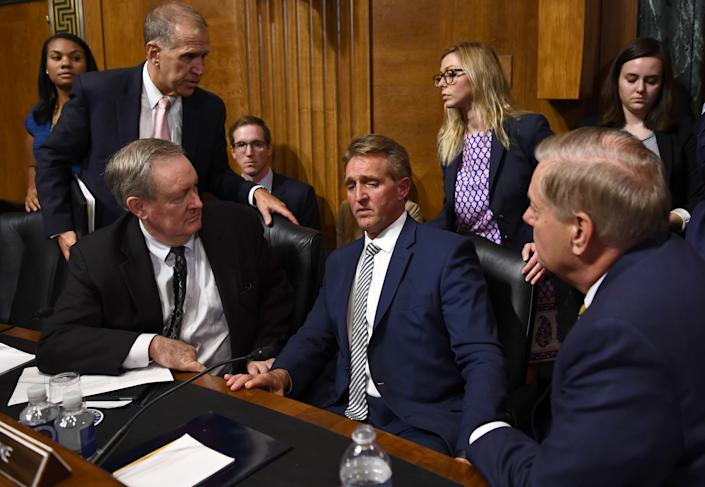 """<span class=""""s1"""">Arizona Republican Jeff Flake, center, talks with colleagues on the Senate Judiciary Committee on Friday. (Photo: Brendan Smialowski/AFP/Getty Images)</span>"""