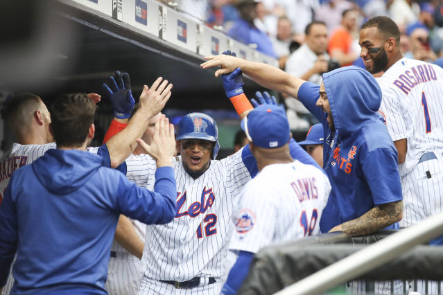 New York Mets' Juan Lagares celebrates after hitting a two run home run during the fifth inning of a baseball game against the Arizona Diamondbacks, Thursday, Sept. 12, 2019, in New York. (AP Photo/Mary Altaffer)