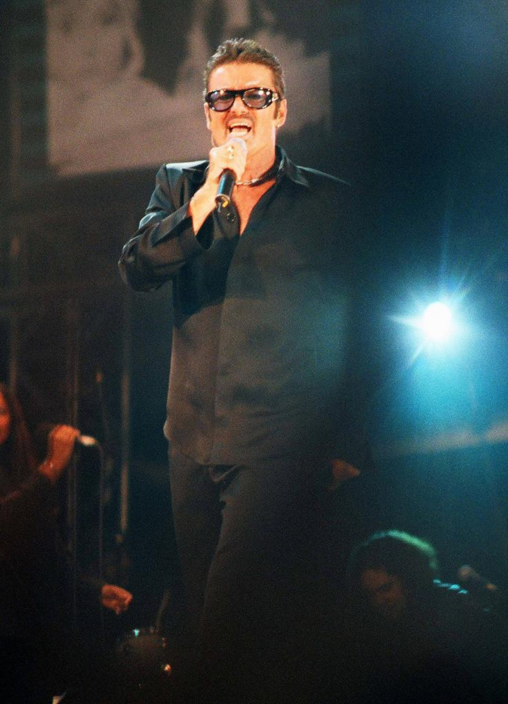<p>George Michael performs at <i>NetAID</i> at Wembley Stadium on Oct. 9, 1999, in London. (Photo: Peter Still/Redferns) </p>