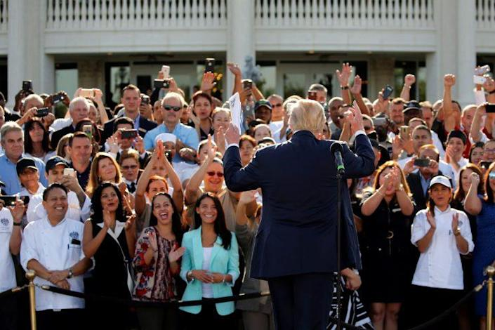 Employees of Donald Trump stand behind him in support at a campaign event at his Trump National Doral golf club outside Miami, Oct. 25, 2016. (Jonathan Ernst/Reuters)