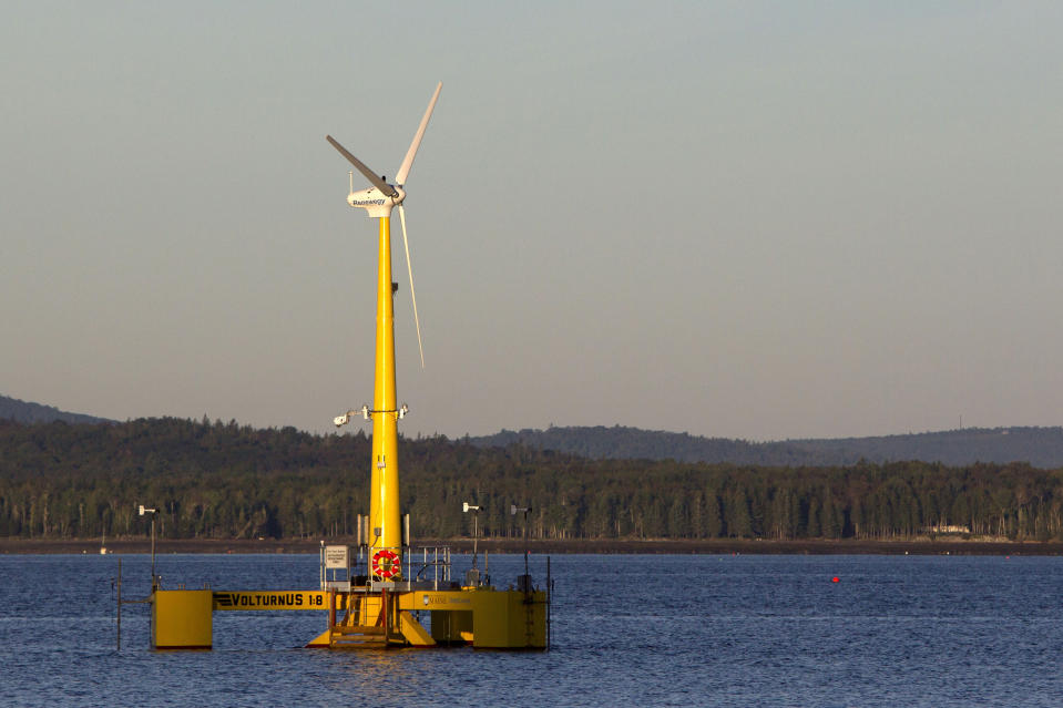 FILE - In this Sept. 20, 2013, file photo, the University of Maine's 9,000-pound prototype, generates power off the coast of Castine, Maine. Though this is only one of two operational U.S. wind farms in 2021, members of the wind power industry and clean energy advocates are hoping that President Joe Biden's administration can transform the country into a leader in offshore wind power. (AP Photo/Robert F. Bukaty, File)
