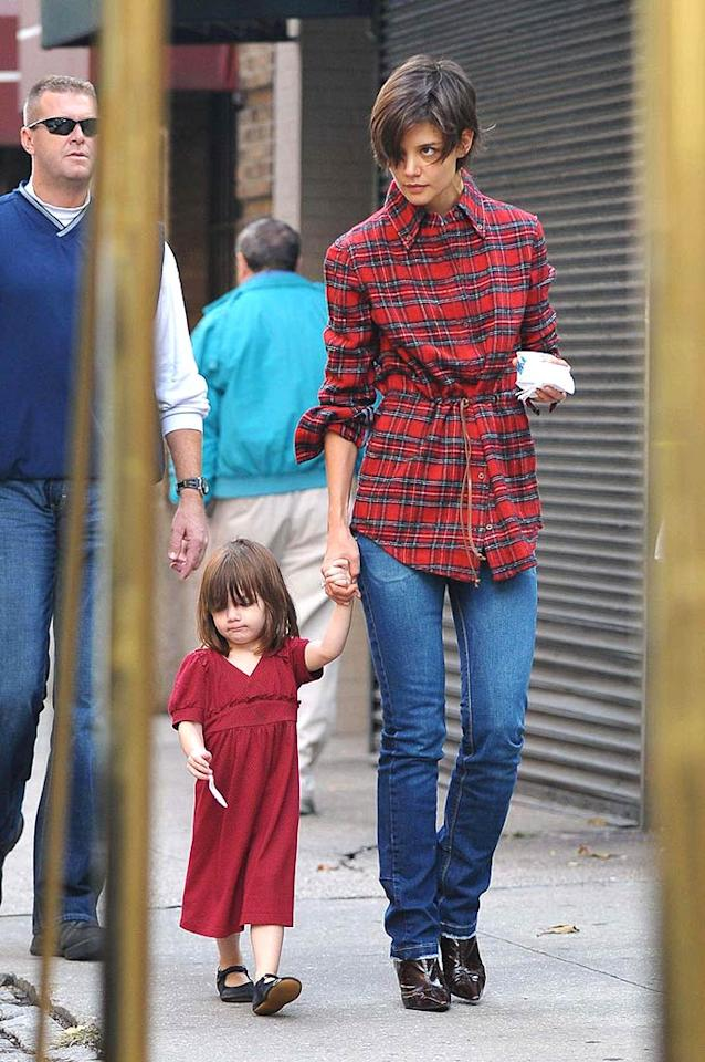 "Katie Holmes and Suri hit the streets of NYC in scarlet ensembles. Edward Opinaldo/<a href=""http://www.pacificcoastnews.com/"" target=""new"">PacificCoastNews.com</a> - October 14, 2008"