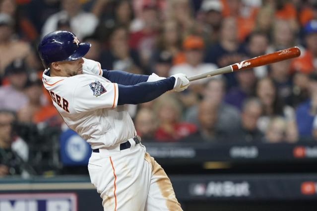 Houston Astros' George Springer hits a home run during the seventh inning of Game 1 of the baseball World Series against the Washington Nationals Tuesday, Oct. 22, 2019, in Houston. (AP Photo/David J. Phillip)