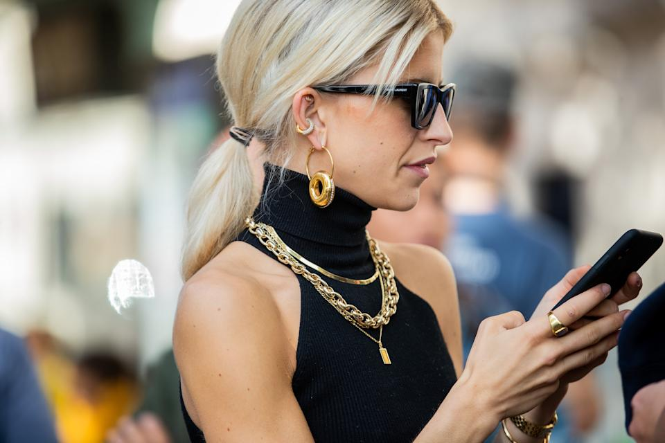 PARIS, FRANCE - SEPTEMBER 30: Caroline Caro Daur seen wearing jewellery: golden earrings, necklace and ring, sunglasses outside Sacai during Paris Fashion Week Womenswear Spring Summer 2020 on September 30, 2019 in Paris, France. (Photo by Christian Vierig/Getty Images)