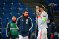 Miss and miss: Spain's Sergio Ramos leaves the pitch after missing two penalties in the 1-1 draw with Switzerland