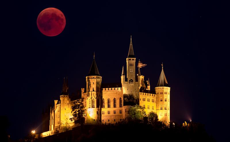 Rising behind The Hohenzollern Castle in Hechingen, Germany. (Matthias Hangst via Getty Images)