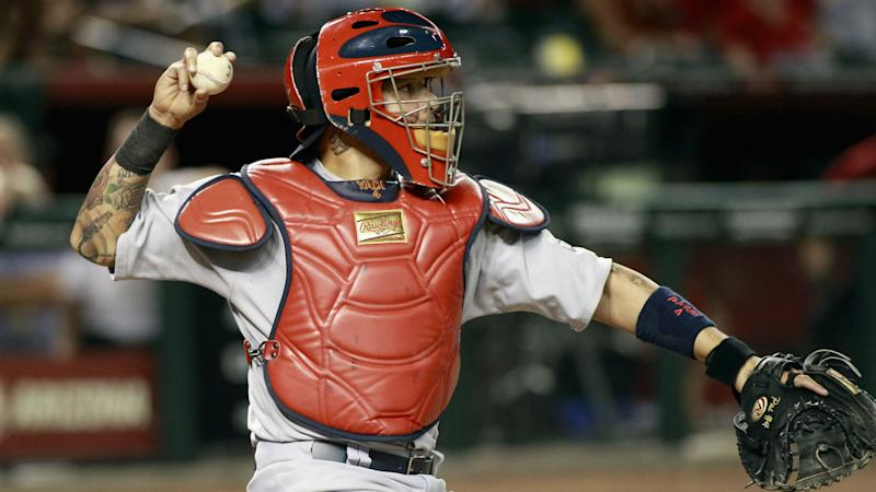 Cardinals catcher Yadier Molina somehow gets baseball stuck on him