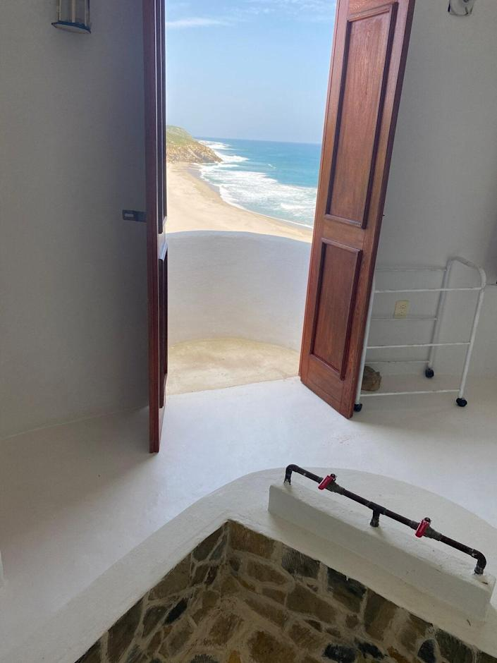 """The view of the Pacific Ocean from this solar-powered, 49-foot lighthouse in San Miguel del Puerto on Mexico's Oaxacan coast is pure romance. With easy access to the beach and ample patio space, this property will have you thrilled to be off the grid and sans WiFi. $125, Airbnb. <a href=""""https://www.airbnb.com/rooms/41522017?"""" rel=""""nofollow noopener"""" target=""""_blank"""" data-ylk=""""slk:Get it now!"""" class=""""link rapid-noclick-resp"""">Get it now!</a>"""