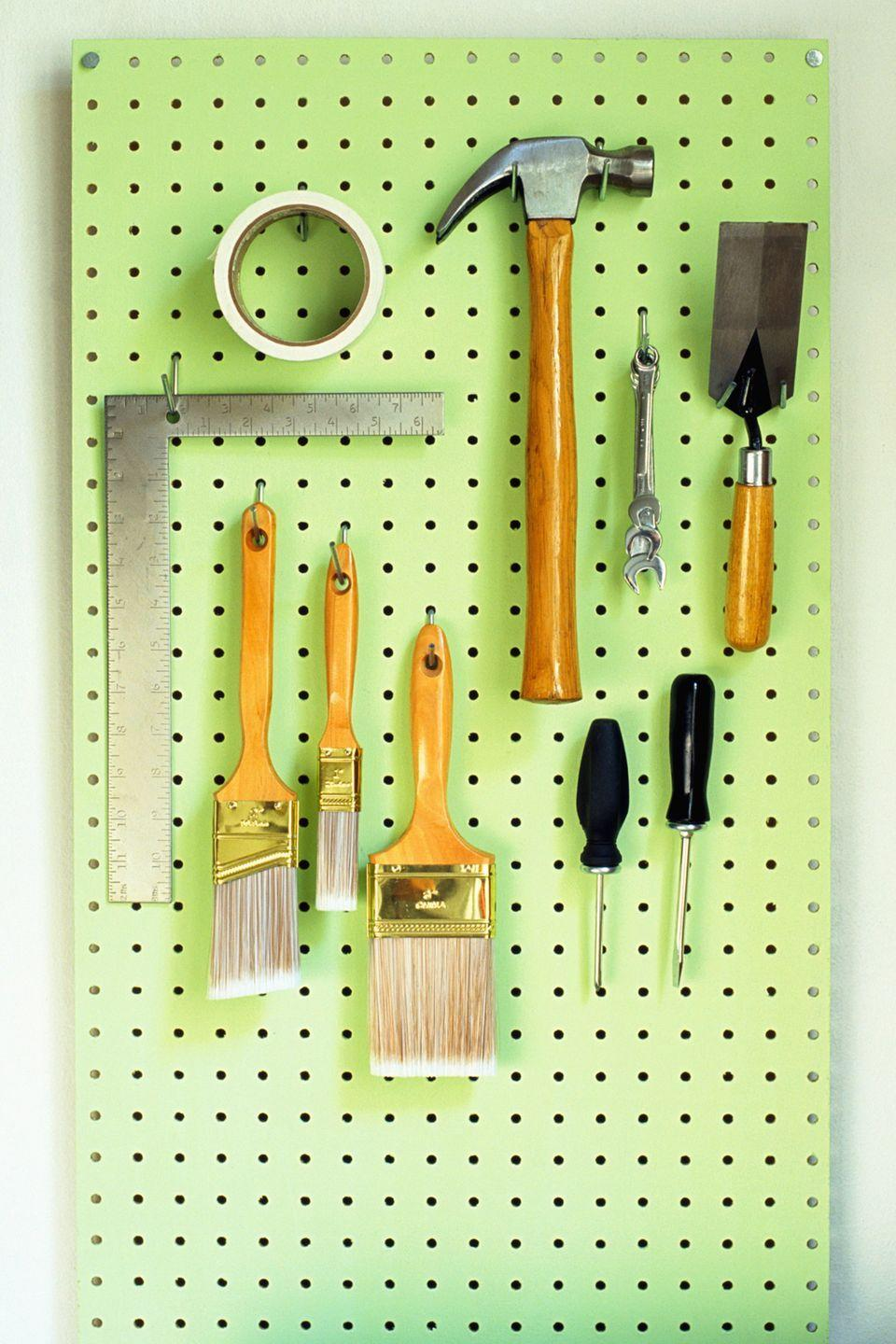 """<p>Hang a spray-painted Peg-Board for tools, coats, baseball caps; use <a href=""""https://www.womansday.com/home/organizing-cleaning/g1957/command-hook-uses/"""" rel=""""nofollow noopener"""" target=""""_blank"""" data-ylk=""""slk:wall hooks"""" class=""""link rapid-noclick-resp"""">wall hooks</a> for blow dryers.</p><p><strong><a class=""""link rapid-noclick-resp"""" href=""""https://www.amazon.com/Rust-Oleum-249123-Painters-Purpose-12-Ounce/dp/B002BWOS6M/r?tag=syn-yahoo-20&ascsubtag=%5Bartid%7C10070.g.3310%5Bsrc%7Cyahoo-us"""" rel=""""nofollow noopener"""" target=""""_blank"""" data-ylk=""""slk:SHOP SPRAY PAINT"""">SHOP SPRAY PAINT</a></strong></p>"""