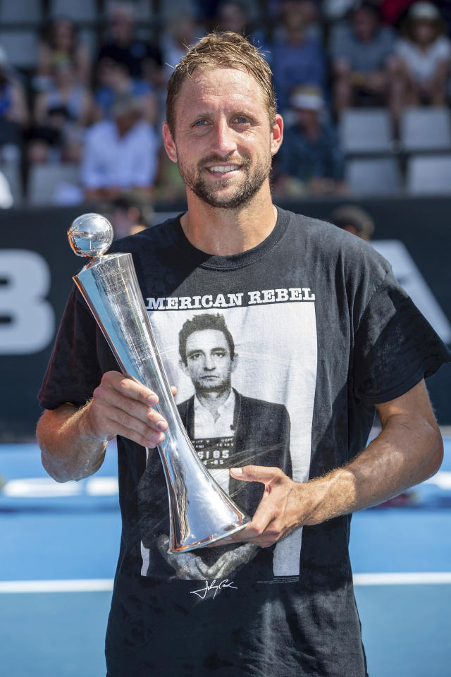 Tennys Sandgren of the U.S. celebrates with the trophy after defeating Britain's Cameron Norrie in their singles final match in the ASB Classic at ASB Tennis Arena in Auckland, New Zealand, Saturday, Jan. 12, 2019. (AP Photo/David Rowland)