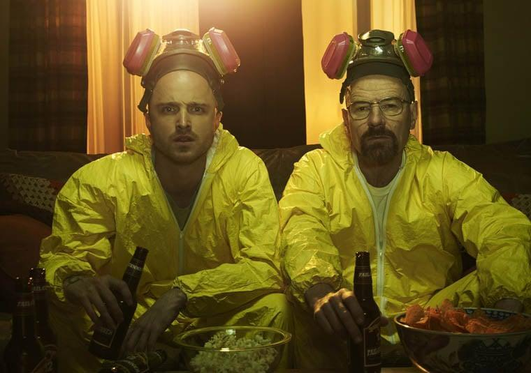 """<ul> <li><strong>What to wear for Walter:</strong> Glasses, a yellow hazmat suit, and a mask. Oh, and you'll have to shave your head and grow a goatee.</li> <li><strong>What to wear for Jesse:</strong> Same as above. Less facial hair - a five-o'clock shadow will do. Add some tattoos for bonus points, and carry around some blue """"meth.""""</li> </ul>"""