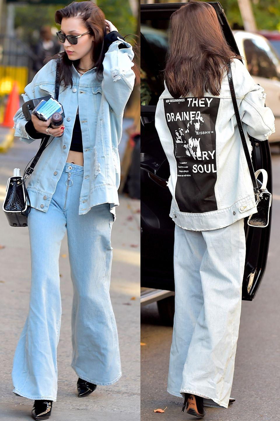 <p>In a denim jacket by Misbhv, wide-leg jeans, pointed-toe Givenchy boots, a black crop top, leather crossbody bag and sunglasses in NYC.</p>