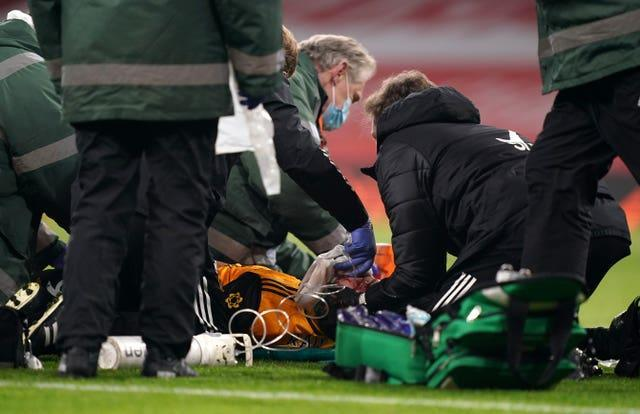 Wolves' Raul Jimenez receives treatment after a clash of heads with Arsenal's David Luiz