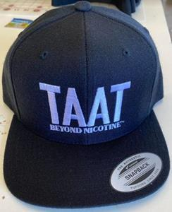 During the boxing match between Floyd Mayweather and Logan Paul on Sunday, June 6, 2021, several members of Mr. Mayweather's entourage will be wearing the baseball hats shown above during their entry into the arena and approach to the boxing ring, allowing for the TAAT™ logo to be highly visible during Mr. Mayweather's entrance and introduction, which will be shown live worldwide through PPV.