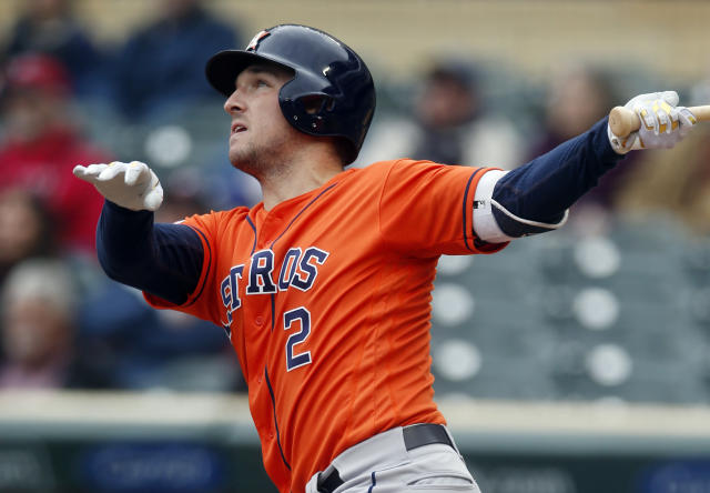 Houston Astros' Alex Bregman follows through as he watches his solo home run off Minnesota Twin pitcher Jose Berrios in the first inning of a baseball game Thursday, May 2, 2019, in Minneapolis. (AP Photo/Jim One)