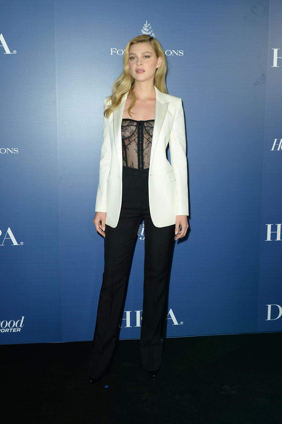 <p>The actor opted for a trouser suit with a sheer bodice, white jacket and black trousers for the festival.<br></p>