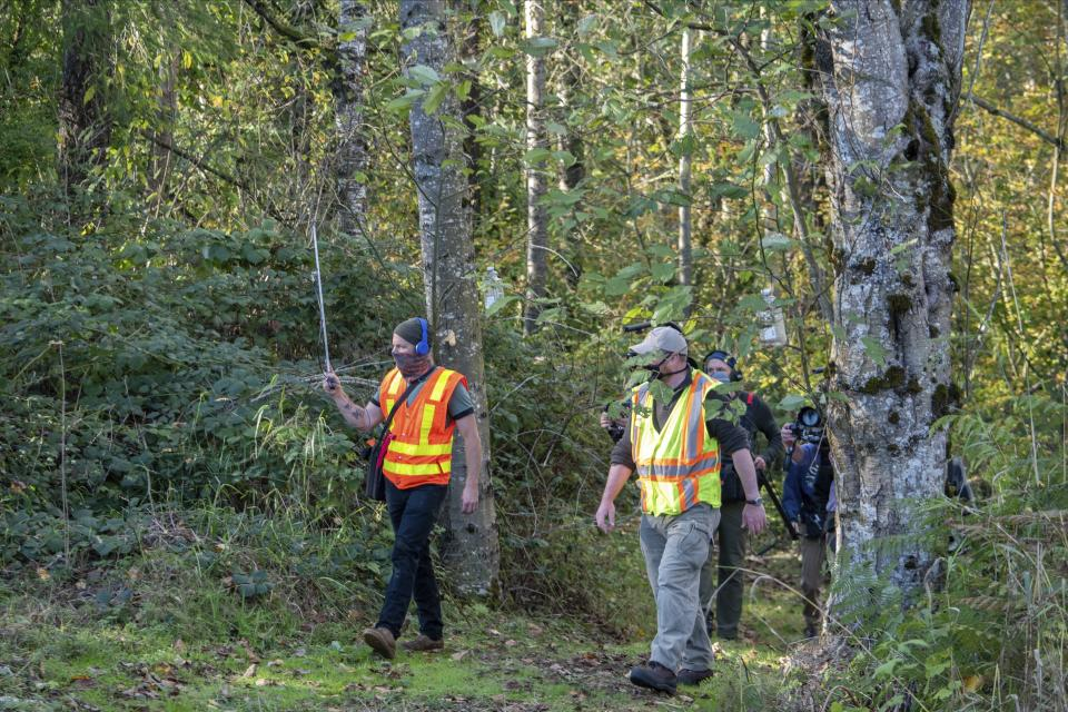 In photo provided by the Washington State Dept. of Agriculture, workers hold an antenna as they follow an Asian Giant Hornet wearing a tracking device, Thursday, Oct. 22, 2020 near Blaine, Wash. Scientists have discovered the first nest of so-called murder hornets in the United States and plan to wipe it out Saturday to protect native honeybees, officials in Washington state said Friday, Oct. 23, 2020. (Karla Salp/Washington Dept. of Agriculture via AP)