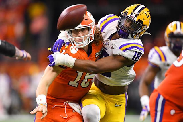 LSU EDGE K'Lavon Chaisson pressures Clemson quarterback Trevor Lawrence during the College Football Playoff national championship at the Mercedes-Benz Superdome on Jan. 13, 2020 in New Orleans, Louisiana. (Photo by Jamie Schwaberow/Getty Images)