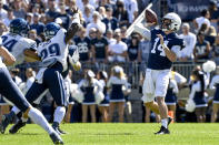 Penn State quarterback Sean Clifford (14) throws a first quarter touchdown pass to wide receiver Jahan Dotson (5) while being pressured by Villanova linebacker Amin Black (29) during an NCAA college football game in State College, Pa., on Saturday, Sept. 25, 2021. (AP Photo/Barry Reeger)