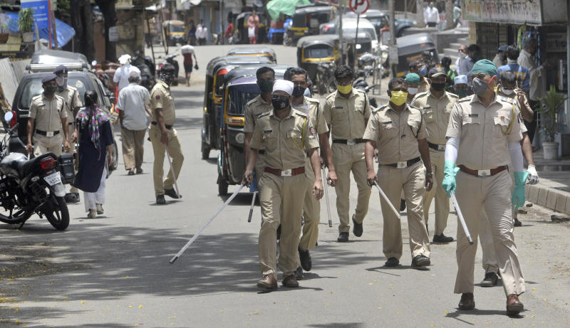 Mumbai Police Conducting Flag March at Anand Nagar, Kurar Village, Malad(W) to enforce strict implementation of the coronavirus-induced lockdown, on June 22, 2020 in Mumbai, India. (Photo by Satyabrata Tripathy/Hindustan Times via Getty Images)