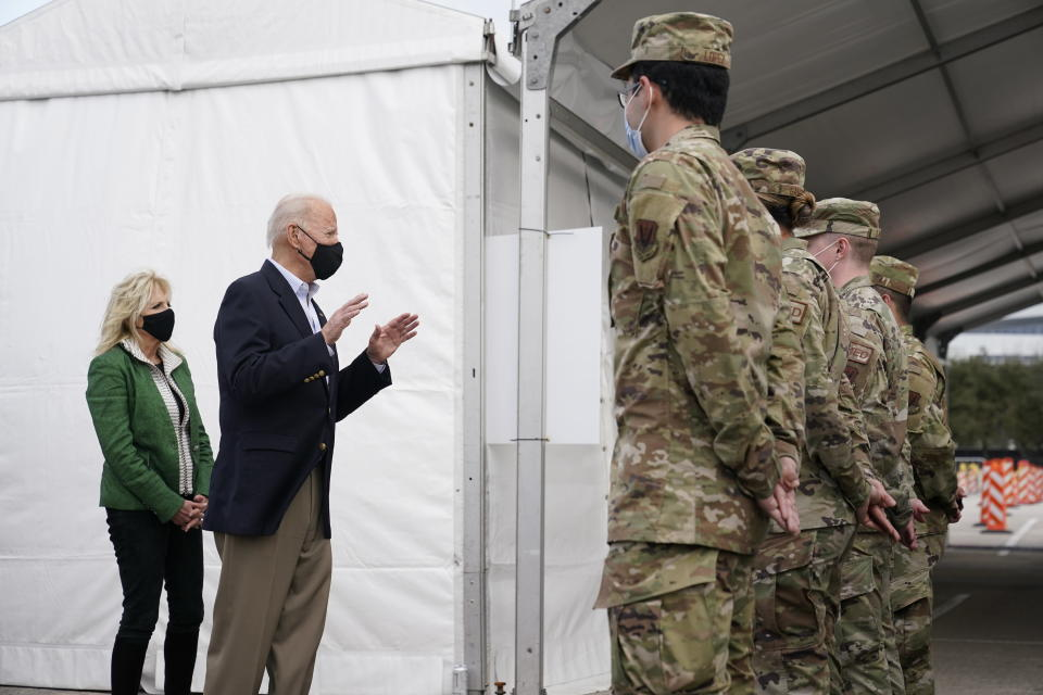 President Joe Biden and first lady Jill Biden meet with troops at a FEMA COVID-19 mass vaccination site at NRG Stadium, Friday, Feb. 26, 2021, in Houston. (AP Photo/Patrick Semansky)