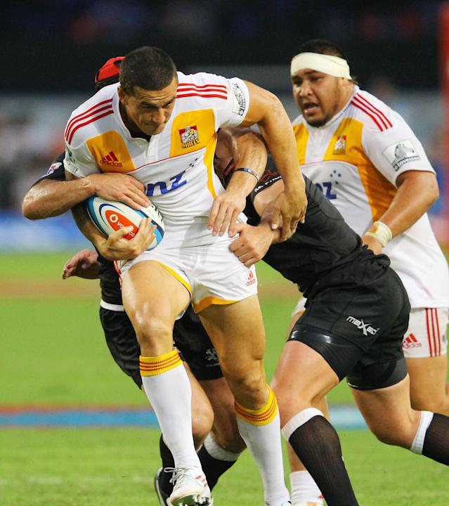 New Zealand Waikato Chiefs' Sonny Bill Williams (L) is tackled by Durban Sharks players during a Super 15 rugby union match at the Mr Price Kings Park Rugby Stadium on April 21, 2012. AFP PHOTO (Photo credit should read -/AFP/Getty Images)