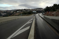 A highway is empty during a lockdown aimed at curbing the spread of the coronavirus, in the Beirut suburb of Roumieh, Lebanon, Thursday, Jan. 14, 2021. Lebanese authorities began enforcing an 11-day nationwide shutdown and round the clock curfew Thursday, hoping to limit the spread of coronavirus infections spinning out of control after the holiday period. (AP Photo/Bilal Hussein)