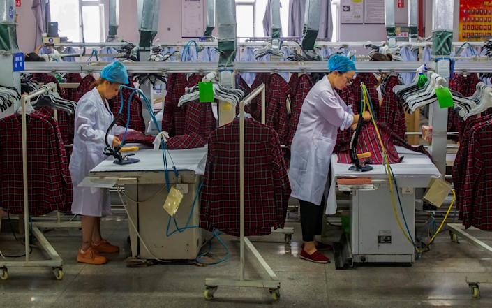 In August, Chinese manufacturing expanded at its fastest rate in nearly 10 years - AP