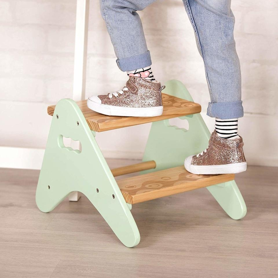 """This will give your kid a ~lift~ while also raising your decor up a couple of notches because it won't clash with the rest of your home.<br /><br /><strong>Promising review:</strong>""""<strong>This is very cute and very easy to assemble.</strong>It arrived when expected and in new condition. It's the perfect height for my 2-year-old to reach the faucet. It's a little heavy for her to pick up but she can push it around just fine."""" —<a href=""""https://www.amazon.com/gp/customer-reviews/RH7L82KFH936A?&linkCode=ll2&tag=huffpost-bfsyndication-20&linkId=cf34605c2416327342fb79c6d013d86c&language=en_US&ref_=as_li_ss_tl"""" target=""""_blank"""" rel=""""nofollow noopener noreferrer"""" data-skimlinks-tracking=""""5854435"""" data-vars-affiliate=""""Amazon"""" data-vars-href=""""https://www.amazon.com/gp/customer-reviews/RH7L82KFH936A?tag=bfmal-20&ascsubtag=5854435%2C26%2C37%2Cmobile_web%2C0%2C0%2C16324255"""" data-vars-keywords=""""cleaning,fast fashion"""" data-vars-link-id=""""16324255"""" data-vars-price="""""""" data-vars-product-id=""""20942643"""" data-vars-product-img="""""""" data-vars-product-title="""""""" data-vars-retailers=""""Amazon"""">Liz<br /><br /></a><strong>Get it from Amazon for<a href=""""https://www.amazon.com/B-spaces-Battat-boost-Toddler/dp/B072R7138Z?&linkCode=ll1&tag=huffpost-bfsyndication-20&linkId=ea3e7124eea01a9330f77d66494d5f4c&language=en_US&ref_=as_li_ss_tl"""" target=""""_blank"""" rel=""""nofollow noopener noreferrer"""" data-skimlinks-tracking=""""5854435"""" data-vars-affiliate=""""Amazon"""" data-vars-asin=""""B072R7138Z"""" data-vars-href=""""https://www.amazon.com/dp/B072R7138Z?tag=bfmal-20&ascsubtag=5854435%2C26%2C37%2Cmobile_web%2C0%2C0%2C16323402"""" data-vars-keywords=""""cleaning,fast fashion"""" data-vars-link-id=""""16323402"""" data-vars-price="""""""" data-vars-product-id=""""18412388"""" data-vars-product-img=""""https://m.media-amazon.com/images/I/41C+V-SSOQL.jpg"""" data-vars-product-title=""""B. spaces by Battat – Kids Wooden Two Step Stool – Peek-A-Boost – Mint & Wood"""" data-vars-retailers=""""Amazon"""">$26.95</a>.</strong>"""