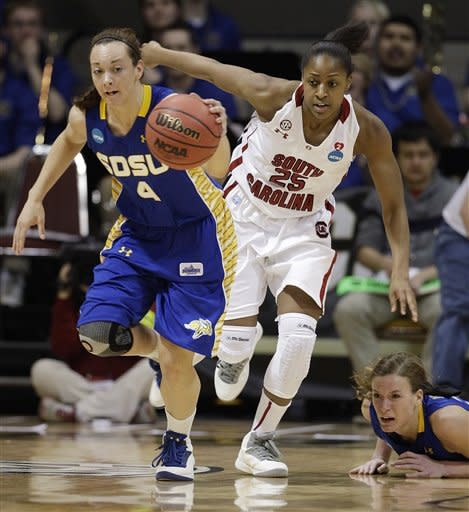 South Dakota State guard Gabrielle Boever (4) breaks away with the ball as South Carolina guard Tiffany Mitchell (25) pursues during the first half of a first-round women's NCAA college basketball game on Saturday, March 23, 2013, in Boulder. South Dakota State's Megan Waytashek, lower right, looks on. (AP Photo/Brennan Linsley )