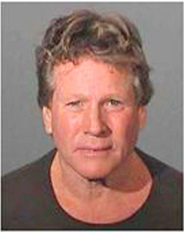 """""""Love Story"""" actor Ryan O'Neal was arrested on February 3, 2007 on suspicions of assault with a deadly weapon and negligent discharge of a firearm after an altercation with his son Griffin. <a href=""""http://www.splashnewsonline.com"""" target=""""new"""">Splash News</a> - February 3, 2007"""