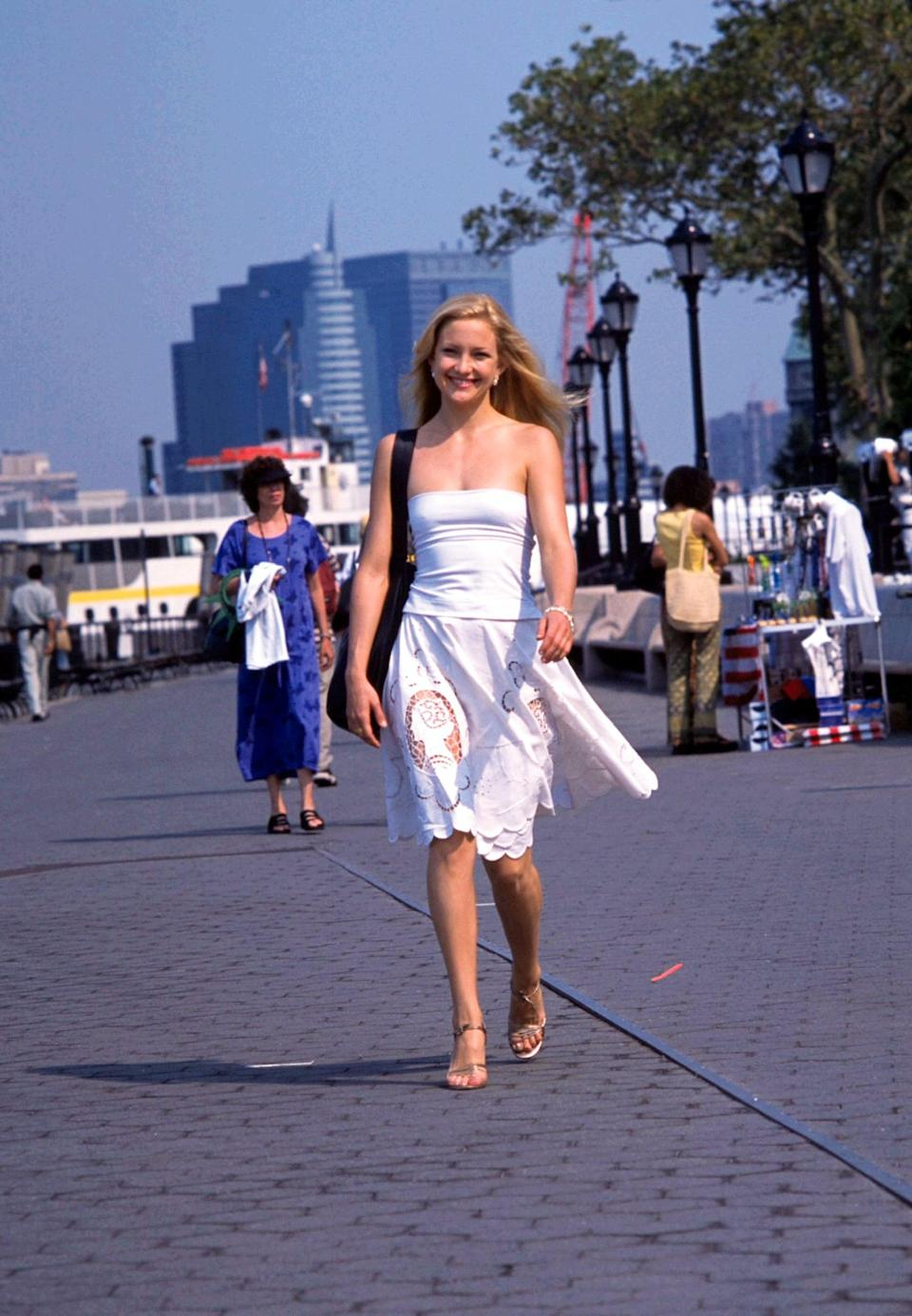 <p>What's more early aughts than a tube top styled with a midi skirt?</p>
