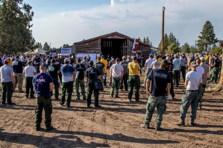 """Firefighters had to withdraw from fast-growing flames and """"extreme fire conditions"""" to the east of the Bootleg Fire in Oregon"""