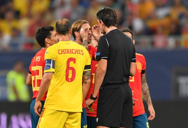 Sergio Ramos (C) of Spain reacts to the referee as he received yellow card after he scored 1-0 against Romania during the Euro 2020 football qualification match between Romania and Spain in Bucharest, Romania, on September 5, 2019. (Photo by Daniel MIHAILESCU / AFP) (Photo credit should read DANIEL MIHAILESCU/AFP/Getty Images)
