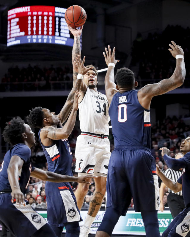 Cincinnati's Jarron Cumberland (34) shoots over Connecticut's Eric Cobb (0) in the first half of an NCAA college basketball game, Saturday, Jan. 12, 2019, in Cincinnati. (AP Photo/John Minchillo)