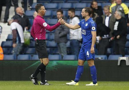 Britain Football Soccer - West Bromwich Albion v Leicester City - Premier League - The Hawthorns - 29/4/17 Referee Mark Clattenburg shakes hands with Leicester City's Danny Drinkwater after the game Reuters / Darren Staples Livepic