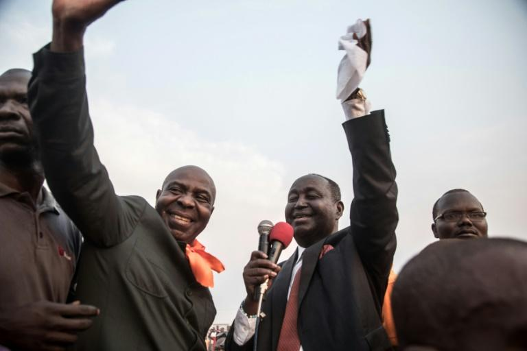 Bozize (L) briefly addressed the crowd that had turned out to welcome him (AFP Photo/FLORENT VERGNES)