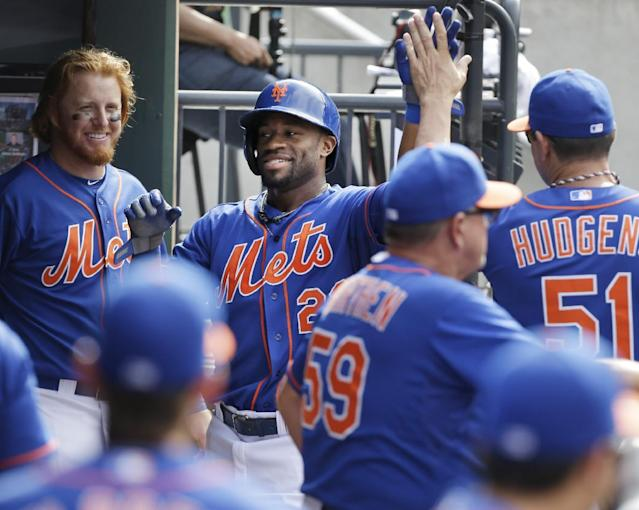 New York Mets' Eric Young Jr., center, is greeted in the dugout at the end of the seventh inning of the baseball game against the Philadelphia Phillies at Citi Field, Thursday, Aug. 29, 2013, in New York. (AP Photo/Seth Wenig)