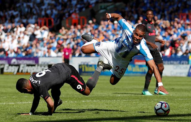 "Soccer Football - Premier League - Huddersfield Town vs Arsenal - John Smith's Stadium, Huddersfield, Britain - May 13, 2018 Arsenal's Alexandre Lacazette in action with Huddersfield Town's Mathias Jorgensen Action Images via Reuters/Andrew Boyers EDITORIAL USE ONLY. No use with unauthorized audio, video, data, fixture lists, club/league logos or ""live"" services. Online in-match use limited to 75 images, no video emulation. No use in betting, games or single club/league/player publications. Please contact your account representative for further details. TPX IMAGES OF THE DAY"