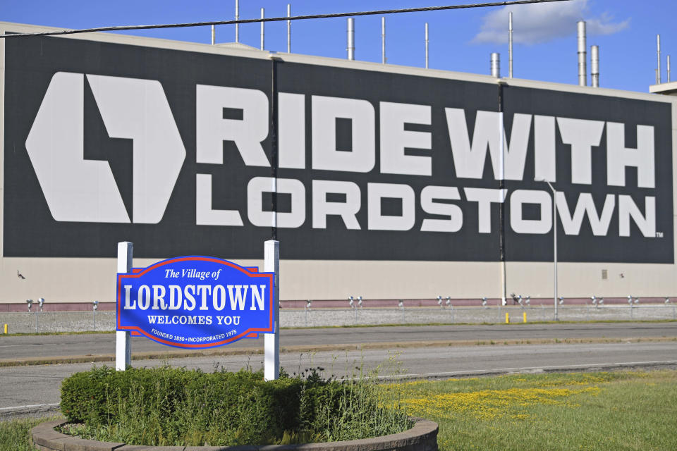 FILE - In this June 22, 2021, file photo, a mural is displayed on the wall outside the Lordstown Motors plant in Lordstown, Ohio. Lordstown Motors, an Ohio company that has come under scrutiny over the number of orders it claimed it had for the electric trucks that it wants to produce, acknowledged that it has received two subpoenas from federal regulators and that prosecutors in New York have opened an investigation. The Securities and Exchange Commission asked in a pair of subpoenas for documents related to the company's merger with DiamondPeak, a special purpose acquisition company. (AP Photo/David Dermer, File)