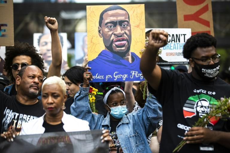 About 1,500 marchers in Minneapolis listened to speeches and joined members of the Floyd family and relatives of other Black people who died in encounters with the police
