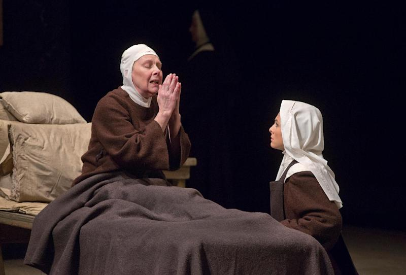 "This April 24, 2013 photo provided by the Metropolitan Opera shows Felicity Palmer as First Prioress, left, and Isabel Leonard as Blanche de la Force in Poulenc's ""Dialogues des Carmélites,"" during a dress rehearsal at the Metropolitan Opera in New York. (AP Photo/Ken Howard)"