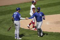 Kansas City Royals' Cam Gallagher, right, celebrates with Hunter Dozier after scoring on a one-run single by Whit Merrifield as Chicago White Sox relief pitcher Jimmy Cordero, top, looks to the field during the sixth inning of a baseball game in Chicago, Sunday, Aug. 30, 2020. (AP Photo/Nam Y. Huh)