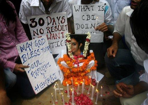 Indian schoolchildren gather with placards and lighted candles around a picture of slain classmate Aarushi Talwar during a rally in New Delhi in 2008. A murder case that has obsessed India for four years will come to court on Friday when a middle-class couple from Delhi stand trial on charges of killing their teenage daughter and domestic servant