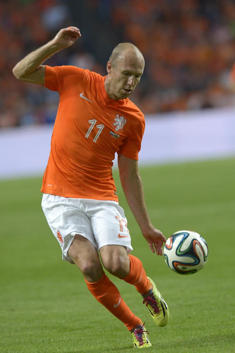 Netherlands player Arjen Robben controls the ball during the international friendly soccer match against Wales at ArenA stadium in Amsterdam, Netherlands, Wednesday June 4, 2014. (AP Photo/Ermindo Armino)