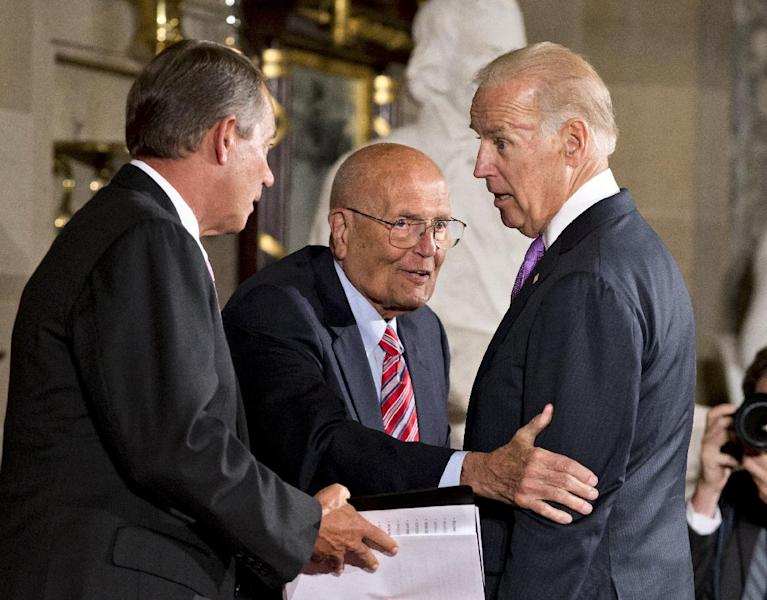 Rep. John Dingell, D-Mich., who recently became the longest-serving member of Congress, is celebrated by colleagues, including Vice President Joe Biden, right, and Speaker of the House John Boehner, R-Ohio, left, on Capitol Hill in Washington, Thursday, June 13, 2013. A former chairman of the Energy and Commerce Committee, Dingell, now 86, says he has no plans to retire as the representative of Michigan's 12th District that takes in Dearborn and Ypsilanti. (AP Photo/J. Scott Applewhite)