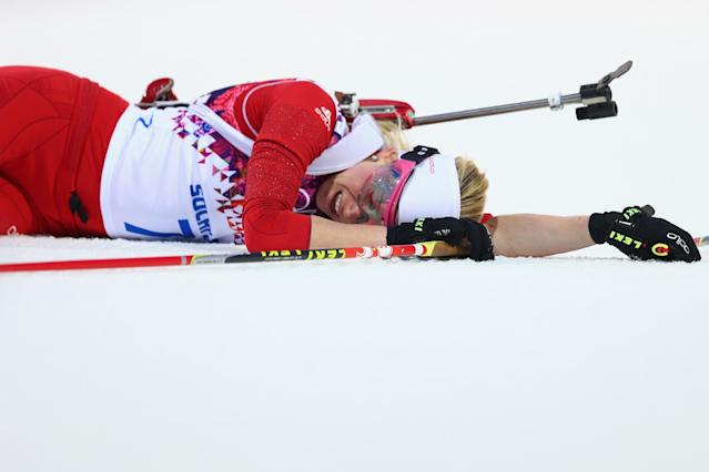 SOCHI, RUSSIA - FEBRUARY 14: Elisa Gasparin of Switzerland collapses at the finish line in the Women's 15 km Individual during day seven of the Sochi 2014 Winter Olympics at Laura Cross-country Ski & Biathlon Center on February 14, 2014 in Sochi, Russia. (Photo by Paul Gilham/Getty Images)
